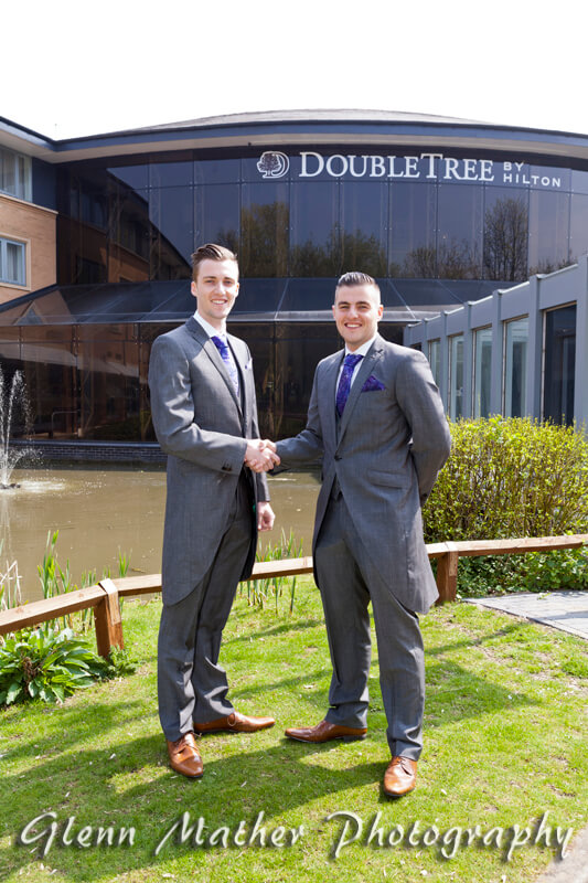 Groom and bestman arrive at Double Tree Hotel