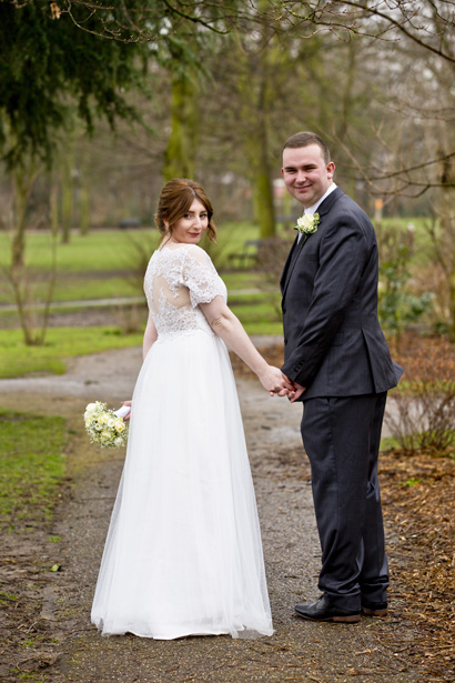 bride and groom in west bridgford park after wedding