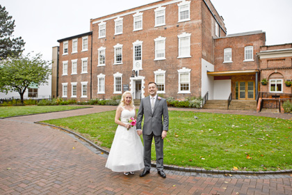 bride and groom outside bridgford hall after wedding