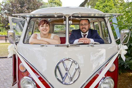 bride and groom outside bridgford hall in vw van