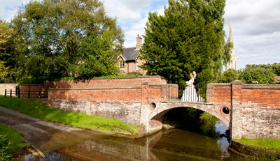 lovely bride and groom on bridge