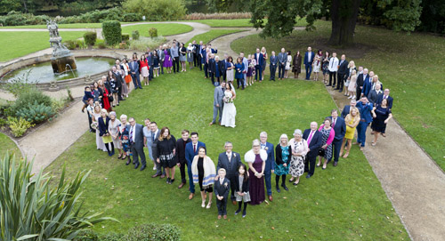 wedding guests make heart shape