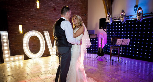 bride and grooms first dance together